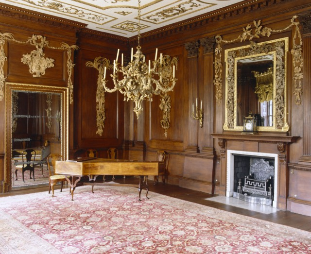 The Saloon towards the fireplace, mirror and walnut harpsichord, at Lyme Park, Stockport, Cheshire